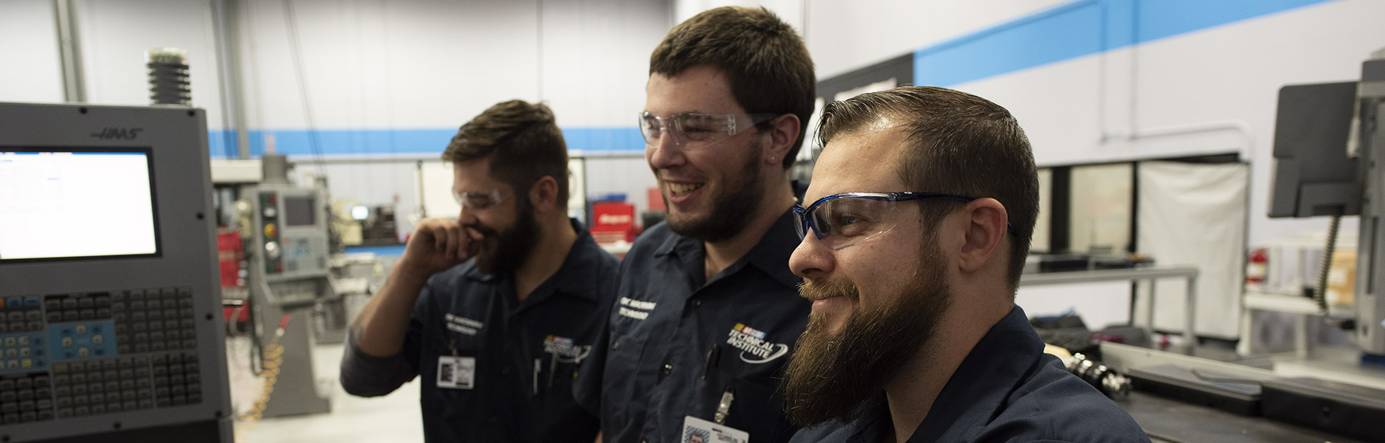 Students smiling in training