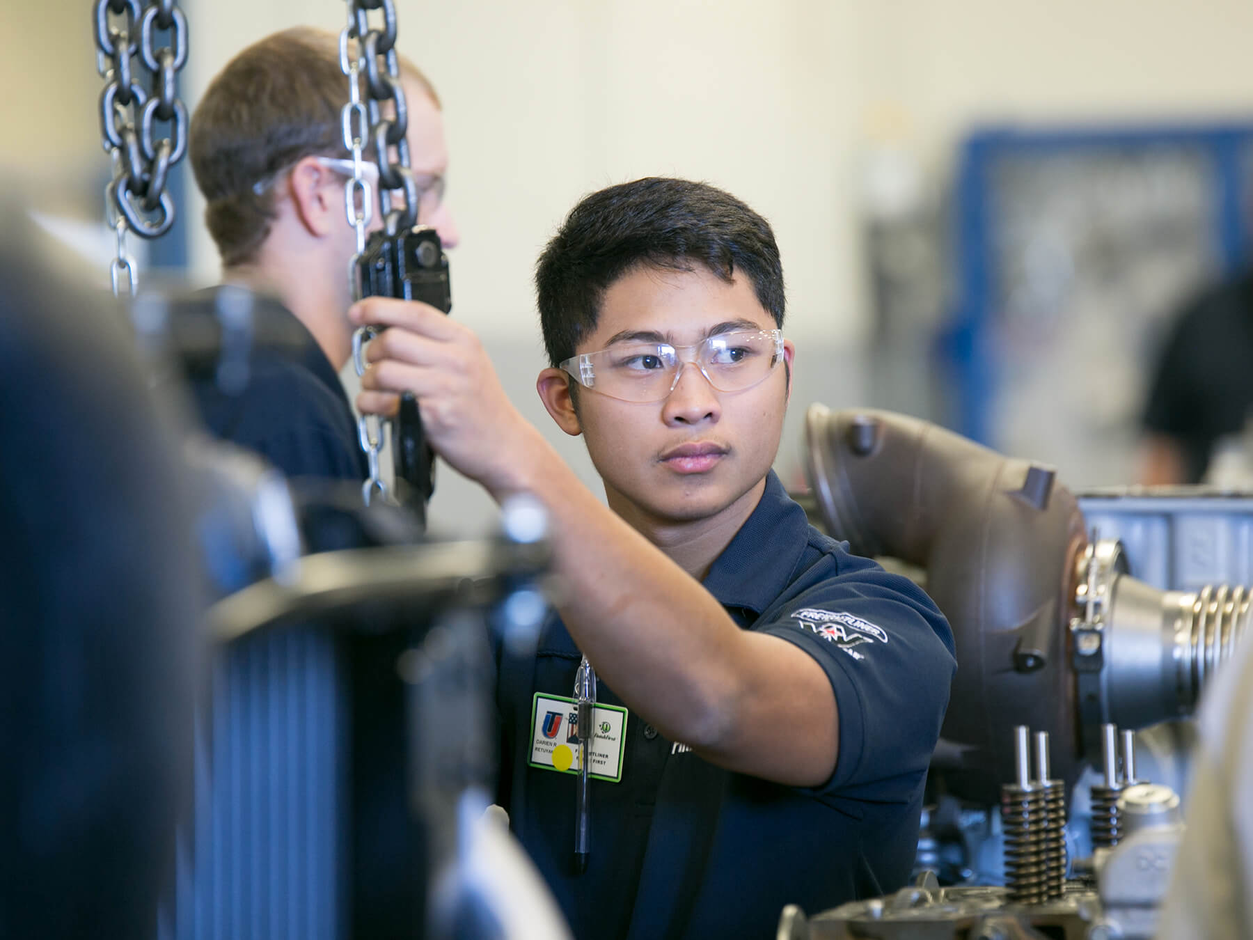 Diesel Freightliner Students working on an engine at Avondale Campus