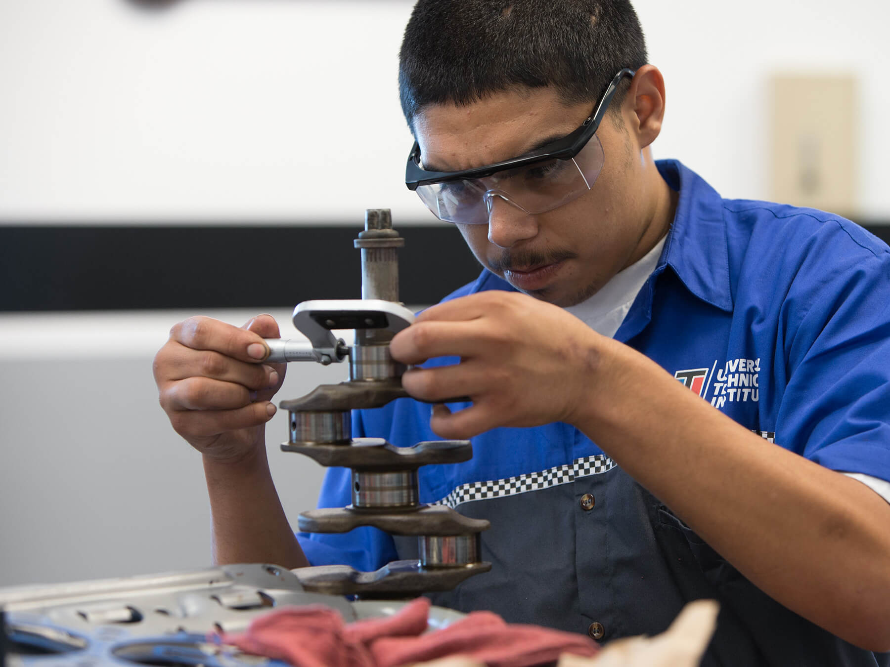 UTI student looking at an auto part