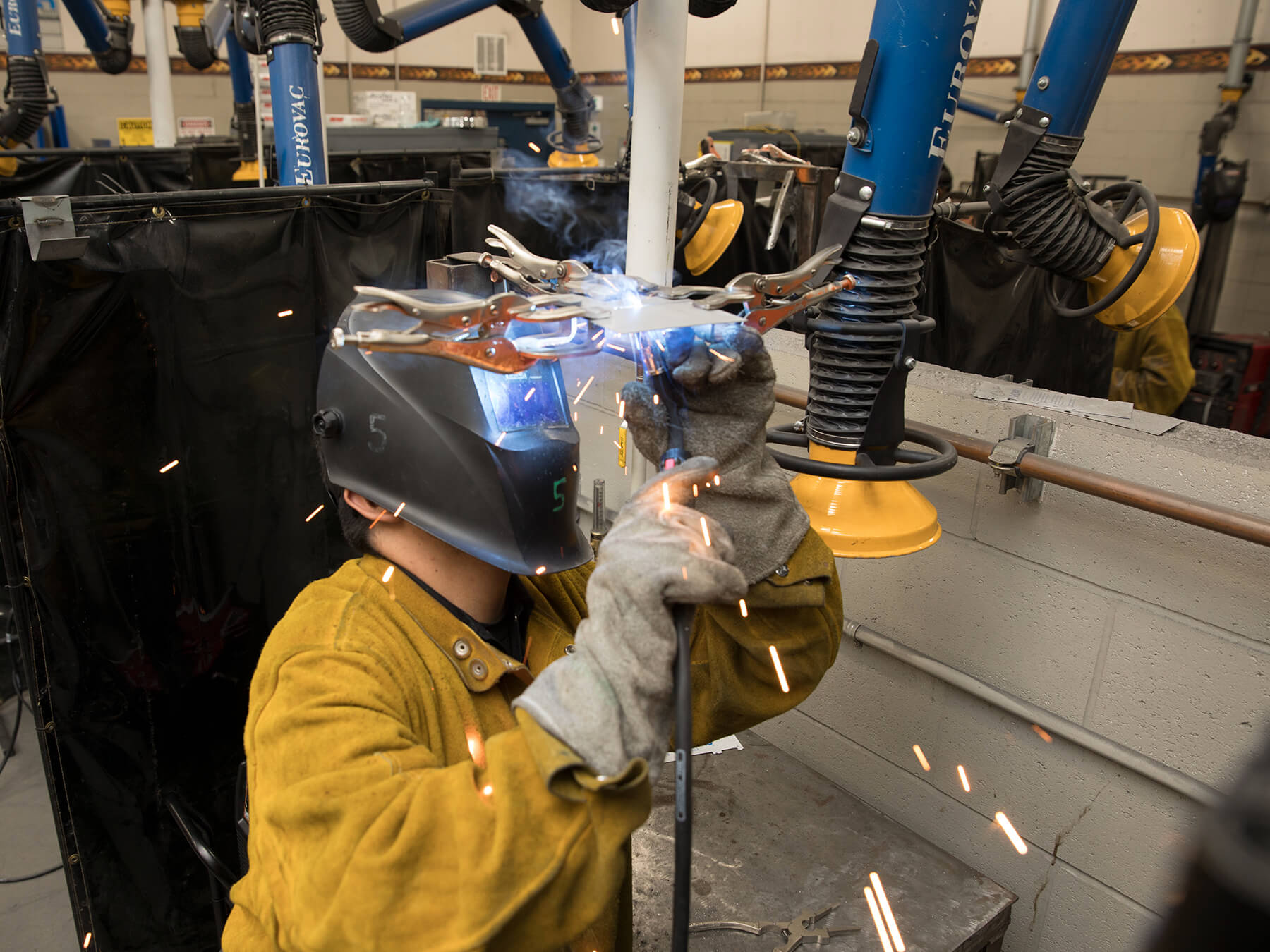 Student welding in the CRRT lab at Sacramento campus
