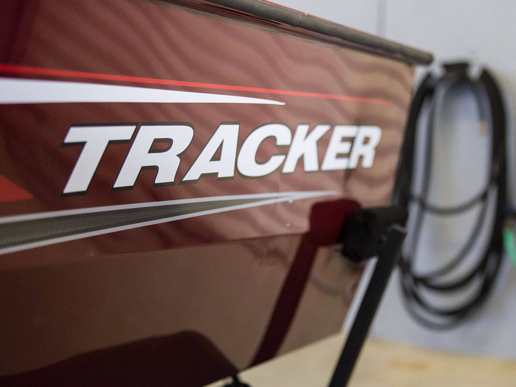 Tracker marine logo on the side of a boat