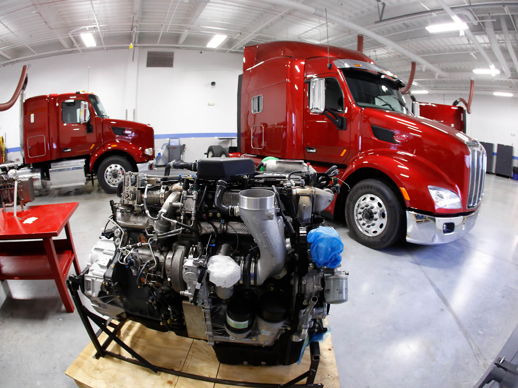 wide angle photo of a diesel engine and trucks inside the diesel lab