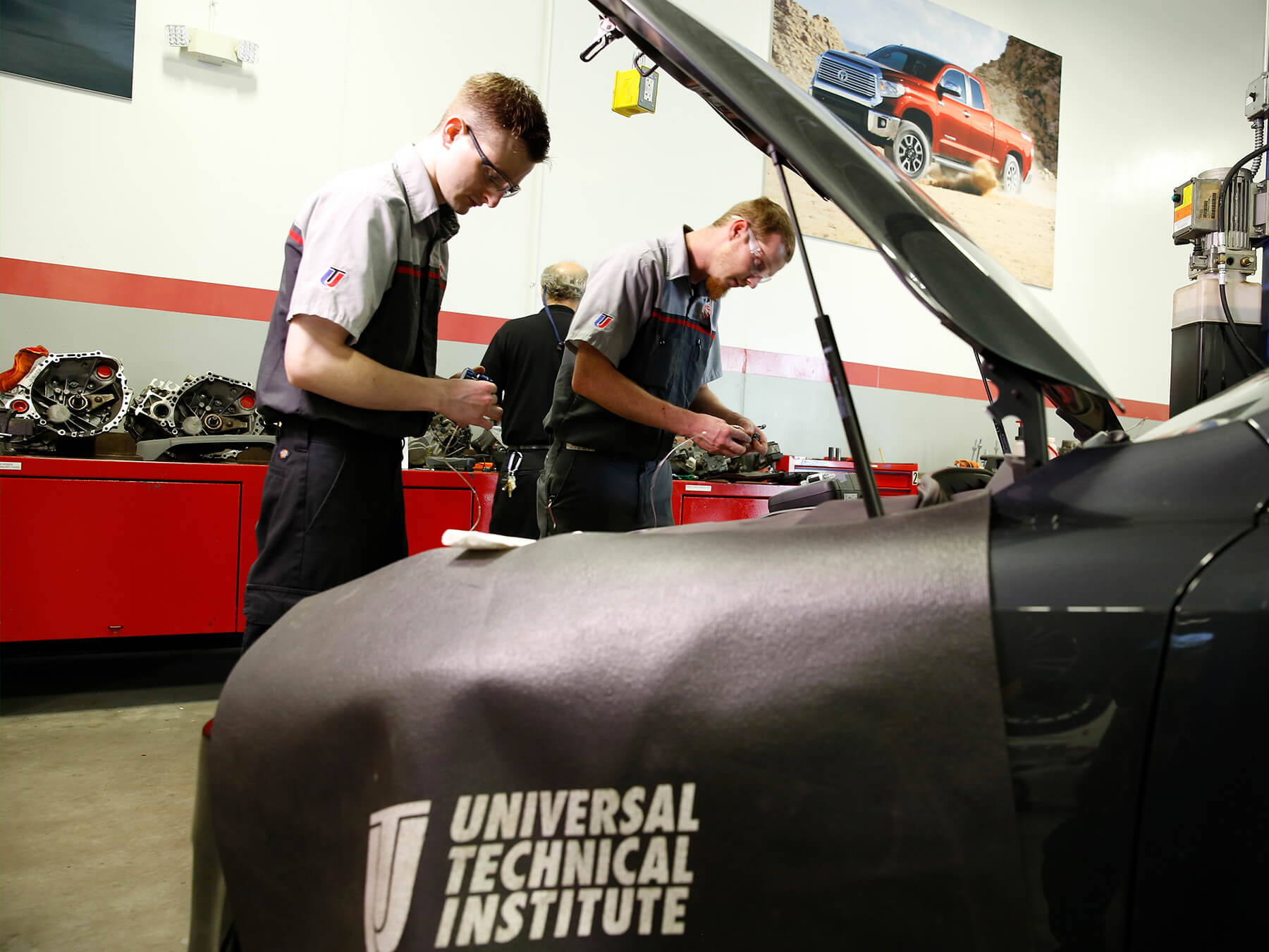 UTI students working under the hood in the Toyota auto lab