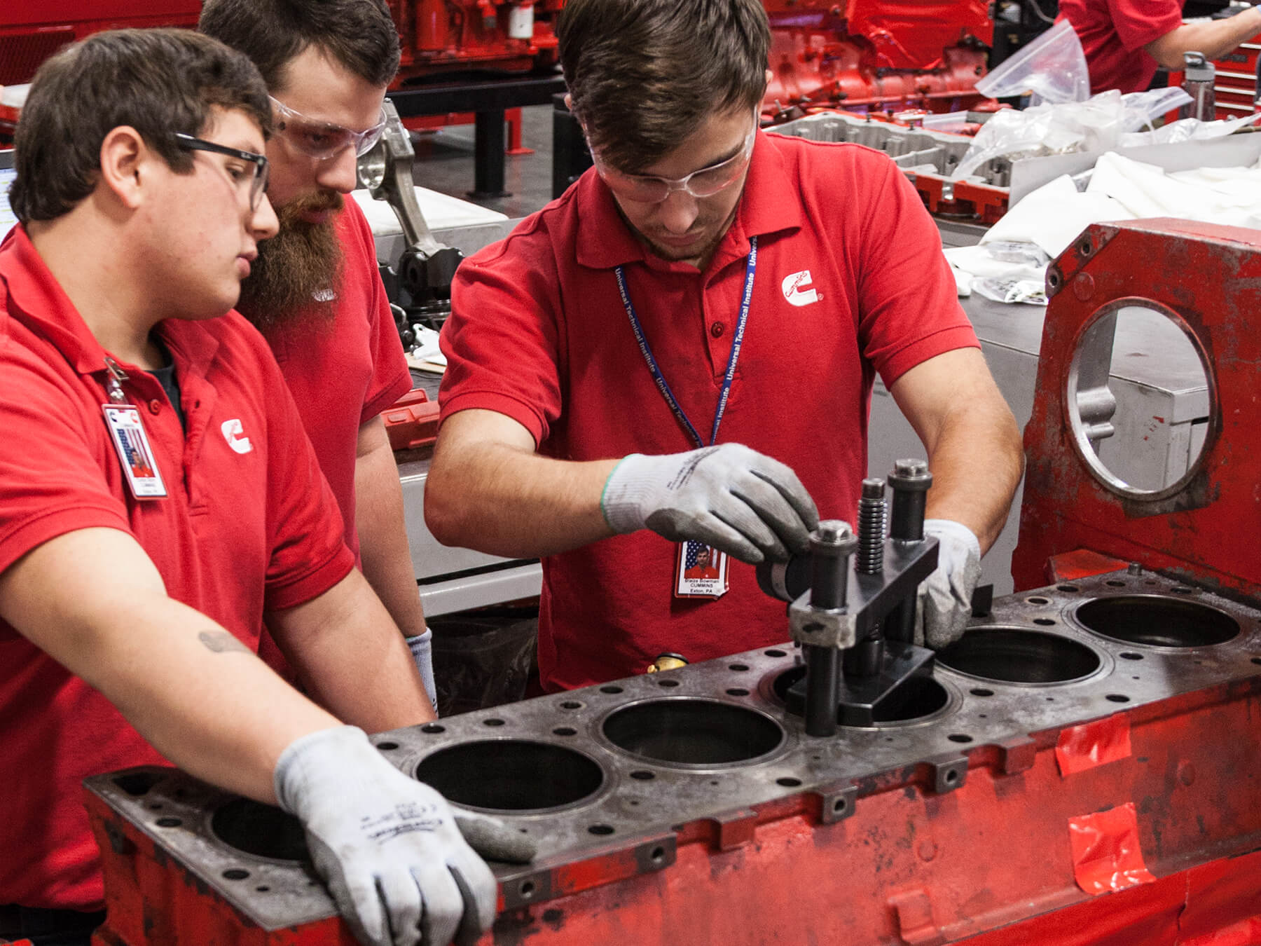 Cummins students working on a diesel engine in the Cummins lab at the Exton campus