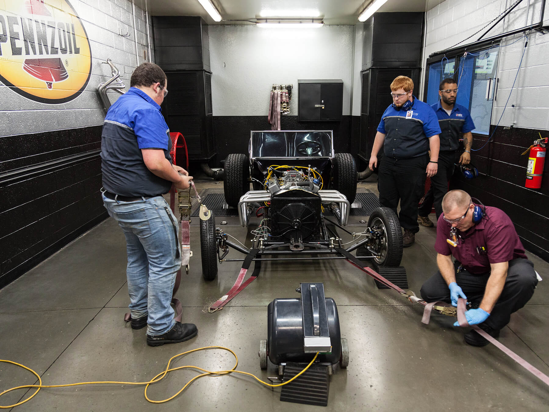 Students and instructor preparing a T-Bucket Hot Rod in the Dyno lab at the Exton campus