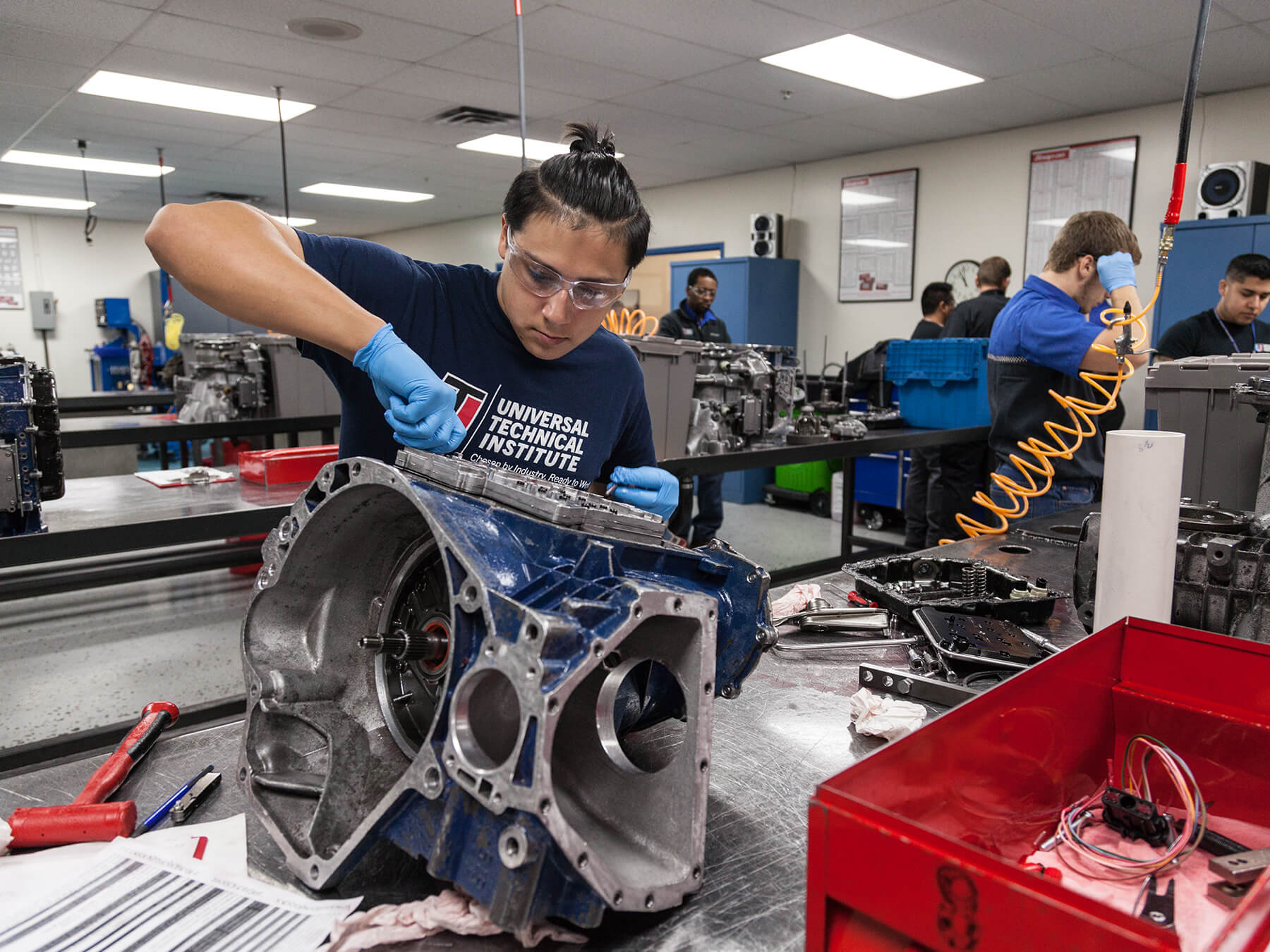 Student working on an engine in the auto classroom at the Exton campus