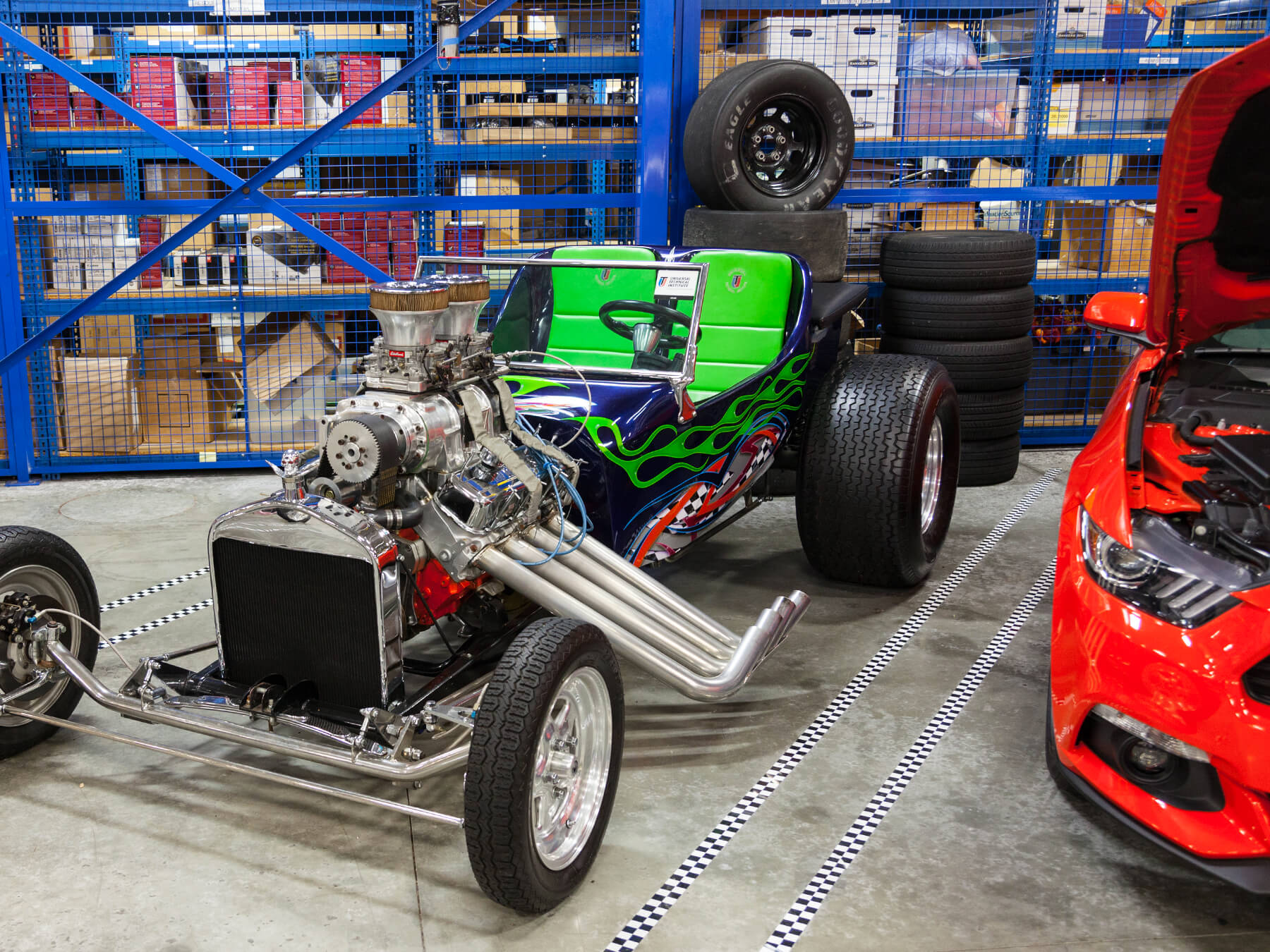 Photo of a Blue T-Bucket hot rod with green flames in the Power Performance lab at the Exton campus