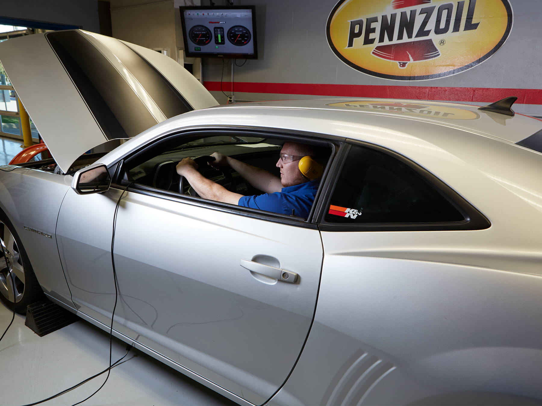 Student in the driver seat in the DYNO room at the Dallas campus