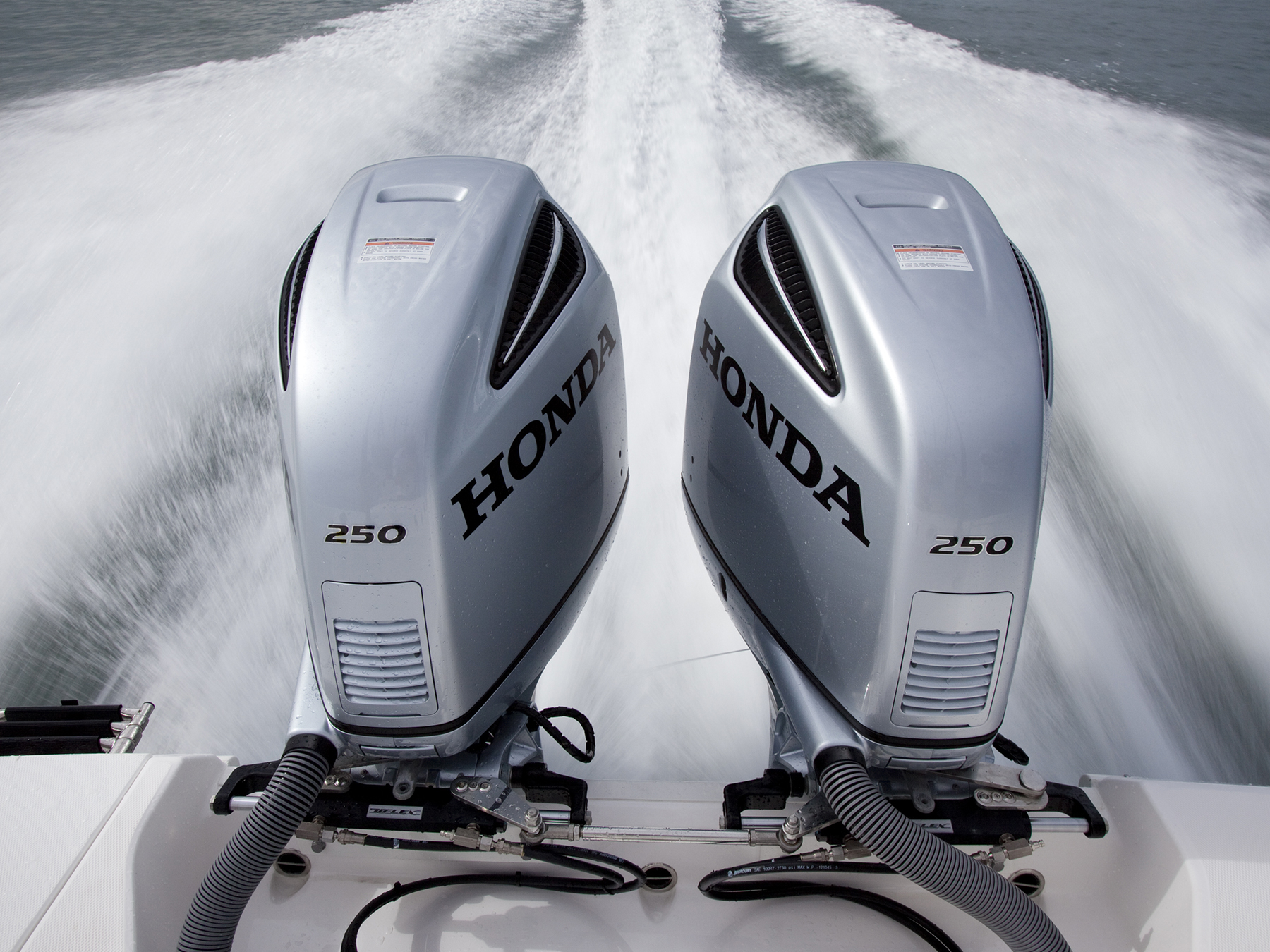 Action shot of 2 Honda 250 engines in the water