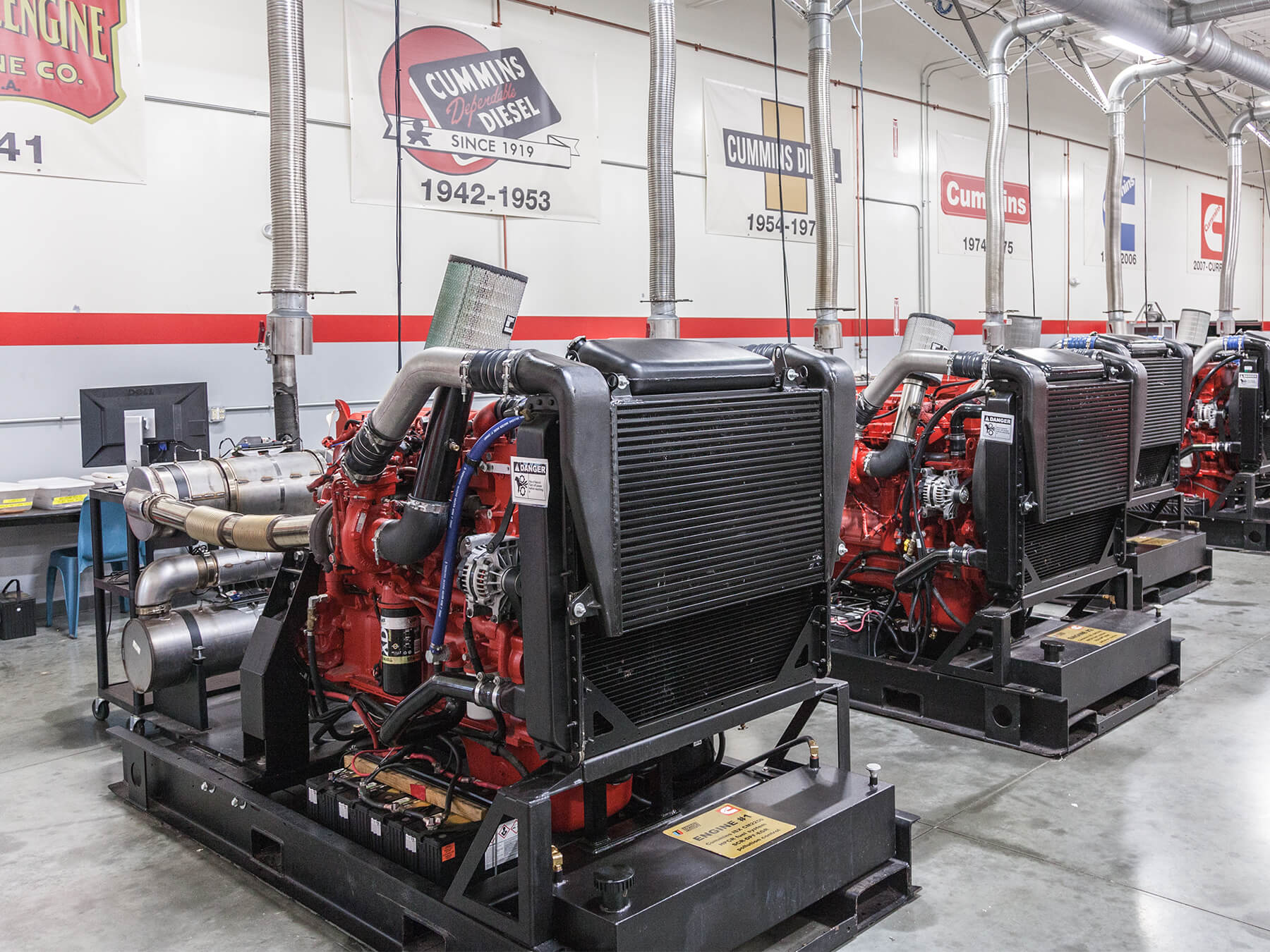 Wide angle photo of cummins diesel engines in the cummins lab