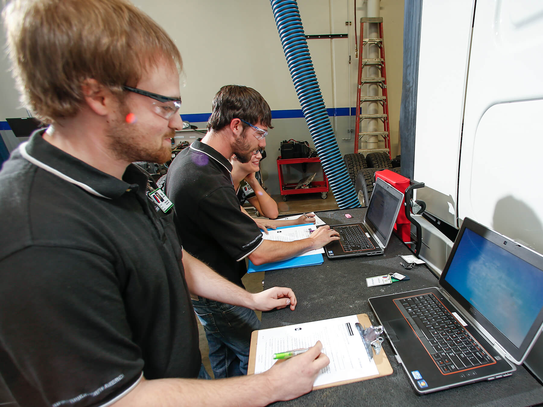 UTI students working on computers