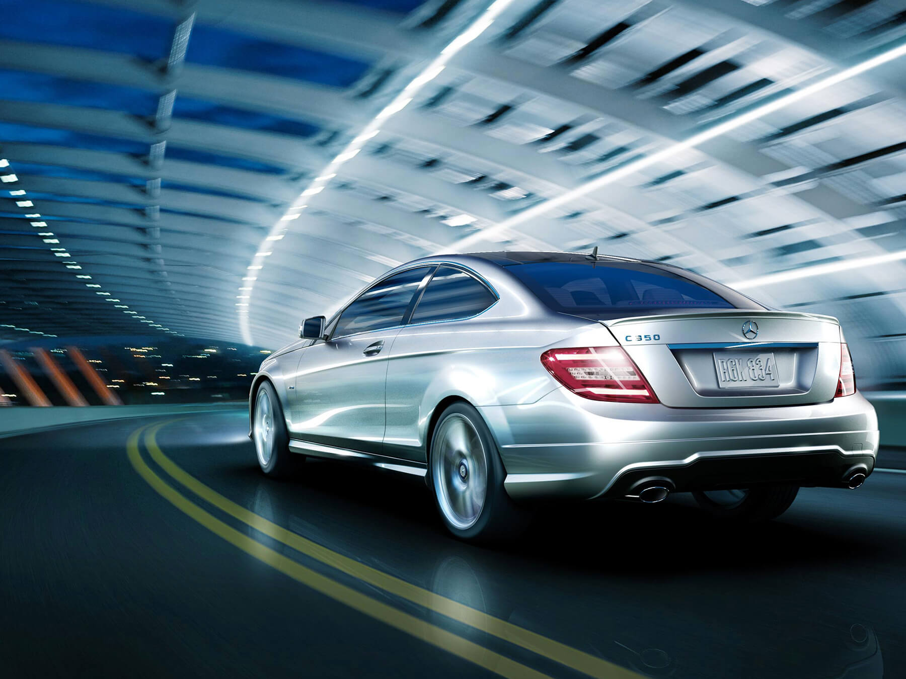 grey Mercedes-benz coupe driving