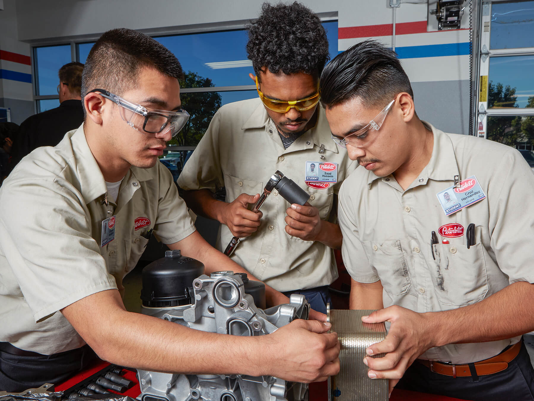 UTI students working on an engine in the peterbilt diesel lab